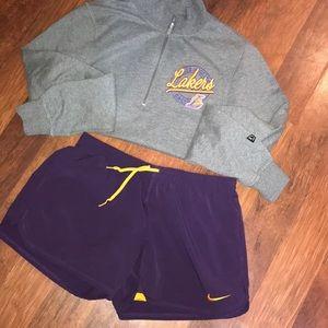 Purple Nike shorts with yellow undershorts
